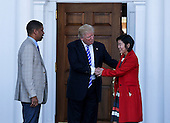 United States President-elect Donald Trump (C) greets Mayor of Sacramento, CA, Kevin Johnson (L) and former chancellor of Washington DC public schools Michelle Rhee (R), at the clubhouse of Trump International Golf Club, November 19, 2016 in Bedminster Township, New Jersey. <br /> Credit: Aude Guerrucci / Pool via CNP