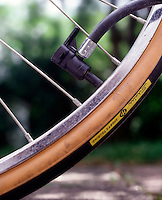PUMPING UP BICYCLE TIRE<br /> (Variations Available)<br /> Air must be forced into the tire to make its internal air pressure greater than the outside normal air pressure.