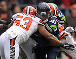 Seattle Seahawks fullback Derrick Coleman (40) runs against the Cleveland Browns linebacker Craig Robertson (53) at CenturyLink Field in Seattle, Washington on December 20, 2015. The Seahawks clinched their fourth straight playoff berth in four seasons by beating the Browns 30-13.  ©2015. Jim Bryant Photo. All Rights Reserved.