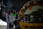 "A silletero waves to the crowd while they attend the traditional ""Silletero"" parade during the Flower Festival in Medellin August 7, 2012. Photo by Eduardo Munoz Alvarez / VIEW."