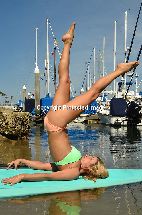 Stock photo Yoga on Paddle board