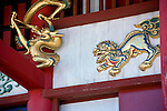 Photo shows a detail of the colorfully decorative exterior of the main Seiden hall inside the grounds of Shuri-jo Castle in Naha, Okinawa Prefecture, Japan, on May 28, 2012. The Seiden functioned as the central structure of the Ryukyu kingdom for over 500 years and is decorated with a wide variety of carvings - this one of a golden dragon.