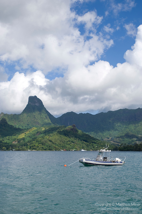 Cook's Bay, Moorea, French Polynesia; views from Gump Research station at the end of Cook's Bay, looking south, including their new research boat, from left to right are Mount Tearai (770 m), Mount Mouaputa (830 m), Mount Tohiea (1207 m) and Mount Rotui (899 m) , Copyright © Matthew Meier, matthewmeierphoto.com All Rights Reserved