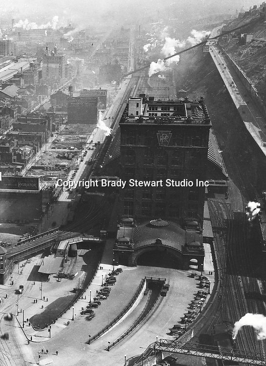 Pittsburgh PA:  View of uptown and Penn Station from the new Koppers Building - 1929.  For only a few years, Penn Station had a Pennsylvania Railroad sign on the side of the building. Strip District, the Penn Incline and Bigelow Blvd in the background.