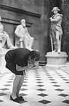 WASHINGTON DC USA 1969. A TOURIST GUIDE CUPS HER HANDS AND WHISPERS TALKING TO THE GROUNDS TO DEMONSTRATE HOW HER VOICE CARRIES TO THE OTHER SIDE OF THE ROOM IN THE CAPITOL BUILDING.