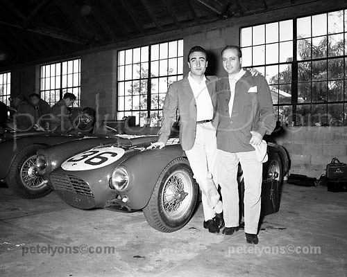Juan Manuel Fangio (R) with team mate Eugenio Castelotti in Lancia garage (the local Pontiac dealership) at Sebring, 1954. Photo by Ozzie Lyons