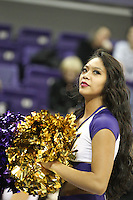 Dec 28, 2014:  Washington cheerleader Casmir Canares entertained fans during the game against Stony Brook.  Stony Brook defeated Washington 62-57 at Alaska Airlines Arena in Seattle, WA.