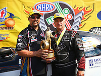 May 17, 2015; Commerce, GA, USA; NHRA funny car driver Tim Wilkerson (right) celebrates with crew chief Richard Hartman after winning the Southern Nationals at Atlanta Dragway. Mandatory Credit: Mark J. Rebilas-USA TODAY Sports