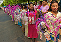 The family, the parents, the sisters (or young village maidens) and the rest of the joyous party in their best silks complete the Shinbyu procession.