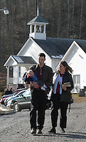 A couple and their child leave the Sago Baptist Church after services Sunday, Jan. 8, 2006,  near the mine where 12 miners were killed in an explosion last Monday near Buckhannon, WV. WV.(Photo by Gary Gardiner)<br />