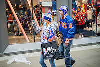 Basketball fans leave the NBA store on Fifth Avenue in Midtown Manhattan in New York on Sunday, December 11, 2016. Only fourteen more days until Christmas.  (© Richard B. Levine)