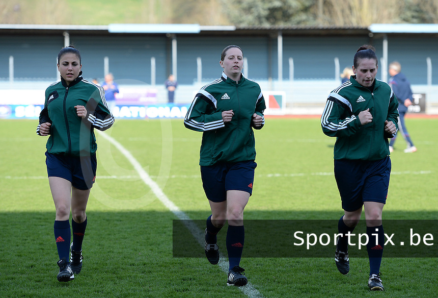 20150406 - MELUN , FRANCE  : French Assistant referee Aurelie Efe pictured with Scottish referee Lorraine Clark (middle) and Scottish assistant referee Nicole Andrews (right) during the soccer match between Women Under 19 teams of Iceland and Russia , on the second matchday in group 3 of the UEFA Elite Round Women Under 19 at Stade Municipal , Melun , France . Monday 6th April 2015 . PHOTO DAVID CATRY