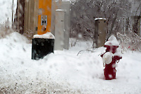 Fire hydrant and electrical control boxes on a street corner in winter