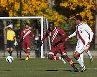 Boston College midfielder/defender Atobra Ampadu (6) attempts to control the ball as Virginia Tech midfielder Andre Thomas (5) defends.Boston College (maroon) defeated Virginia Tech (Virginia Polytechnic Institute and State University) (white), 3-1, at Newton Campus Field, on November 3, 2013.