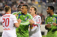 Joel Lindpere (20) of the New York Red Bulls is pushed by Tyrone Marshall (14) of the Seattle Sounders. The Seattle Sounders defeated the New York Red Bulls 1-0 during a Major League Soccer (MLS) match at Red Bull Arena in Harrison, NJ, on May 15, 2010.