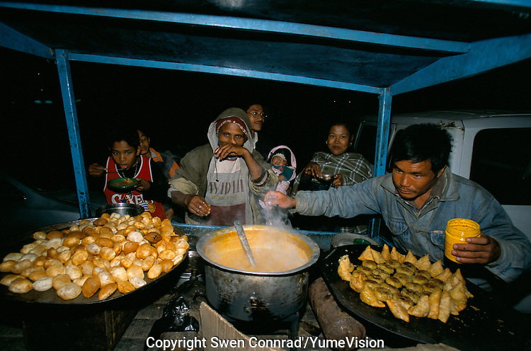 Midnight diner at an ambulant restaurant in Durbar square in Kathmandu City, Nepal