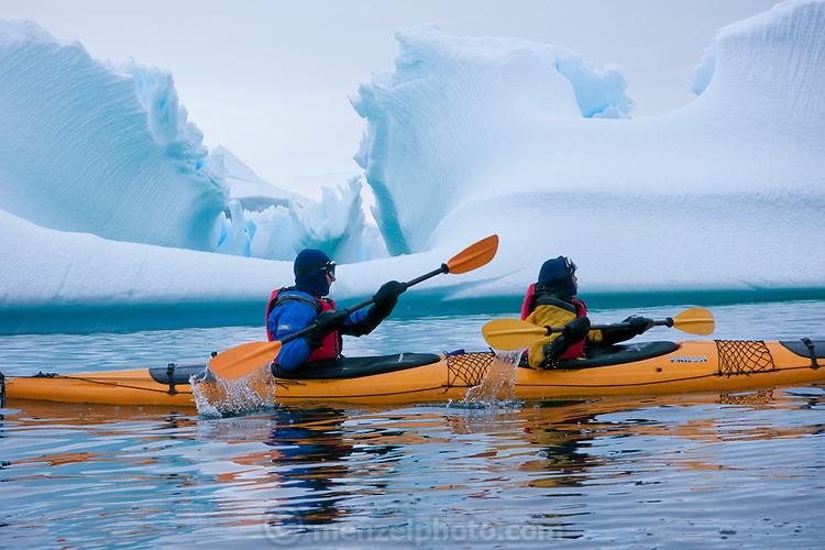 Kayaking by icebergs near Port Lockroy, Antarctic Treaty Historic Site No. 61, British Base A. Home to a small Gentoo penguin colony. Antarctica.