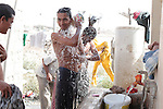 10/10/2014 -- Kirkuk, Iraq -- Bangladeshi workers take a shower in the afternoon during their two hours break.