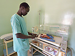 Nurse Angelo Ariec uses a feeding tube to provide nutrition to a premature baby in an incubator at the St. Daniel Comboni Catholic Hospital in Wau, South Sudan.