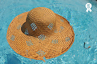 Straw hat floating on pool (Licence this image exclusively with Getty: http://www.gettyimages.com/detail/88088935 )