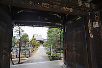 """Temple entrance, Yanaka, Tokyo, Japan, April 20, 2012. Yanaka is part of Tokyo's """"shitamachi"""" historic working class wards. Recently it has become popular with Japanese and foreign tourists for its many temples, shops, restaurants and relaxed atmosphere."""