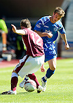 Hearts v St Johnstone...14.08.10  .Chris Millar tackles David Templeton.Picture by Graeme Hart..Copyright Perthshire Picture Agency.Tel: 01738 623350  Mobile: 07990 594431