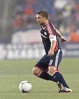 New England Revolution defender Chris Tierney (8) looks to pass. In a Major League Soccer (MLS) match, the New England Revolution defeated Chicago Fire, 2-0, at Gillette Stadium on June 2, 2012.