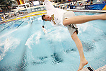 26 MAR 2011:  University of California swimmers celebrate by jumping into the pool after winning the team overall championship during the Division I Men's Swimming and Diving Championship held at the University of Minnesota Aquatics Center in Minneapolis, MN. California won the team championship with 453 points.  Carlos Gonzalez/ NCAA Photos