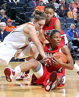 Dec. 6, 2010; Charlottesville, VA, USA; Radford Highlanders guard Denay Wood (11) and Radford Highlanders guard Breshara Gordon (12) fight for the loose ball with Virginia Cavaliers guard Kelsey Wolfe (10) at the John Paul Jones Arena.  Mandatory Credit: Andrew Shurtleff
