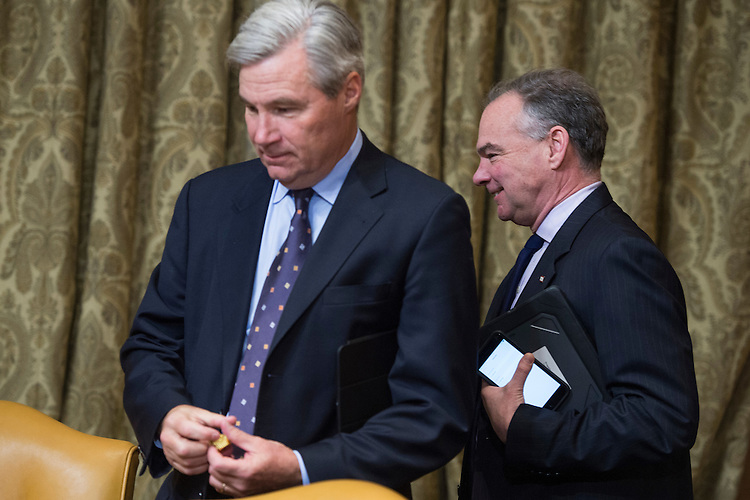 UNITED STATES - JANUARY 24: Sen. Sheldon Whitehouse, D-R.I., left, and Sen. Tim Kaine, D-Va., arrive for the Senate Budget Committee confirmation hearing for Rep. Mick Mulvaney, R-S.C., nominee to be director of the Office of Management and Budget, in Dirksen Building, January 24, 2017. (Photo By Tom Williams/CQ Roll Call)