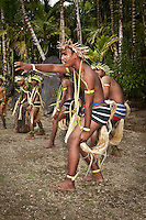 Young man leading the other dancers in a dramatic dance. The traditional dance costume makes imaginative use of local materials, Yap Micronesia. (Photo by Matt Considine - Images of Asia Collection)