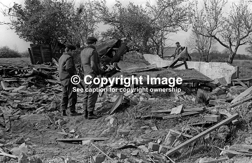 Soldiers at the scene of a Provisonal IRA booby-trap explosion at a derelict cottage In Portadown where 33 year old Roy Rutherford, aka Robert David Rutherford, labourer, married, 3 children, died 15th May 1973. Mr Rutherford, who along with his brother, had been working in an nearby orchard had gone to the cottage to leave their implements there. The bomb exploded when he pushed the door open. The cottage had previously been checked by police and no bomb had been found. 1973050150273<br />