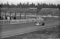 Jody Scheckter raises his arm in triumph as he crosses the finish line in his Tyrrell P34 Formula 1 car to win the 1976 Grand Prix of Sweden at Anderstorp.