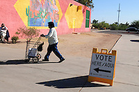 Guadalupe, Arizona. November 6, 2012 - A woman heads towards a voting place in the Town of Guadalupe, Arizona, about 15 minutes from Phoenix. Guadalupe is a small community of Mexicans and Yaqui Indians who utilize the Maricopa County Sheriff's Office as their police force. Photo by Eduardo Barraza © 2012