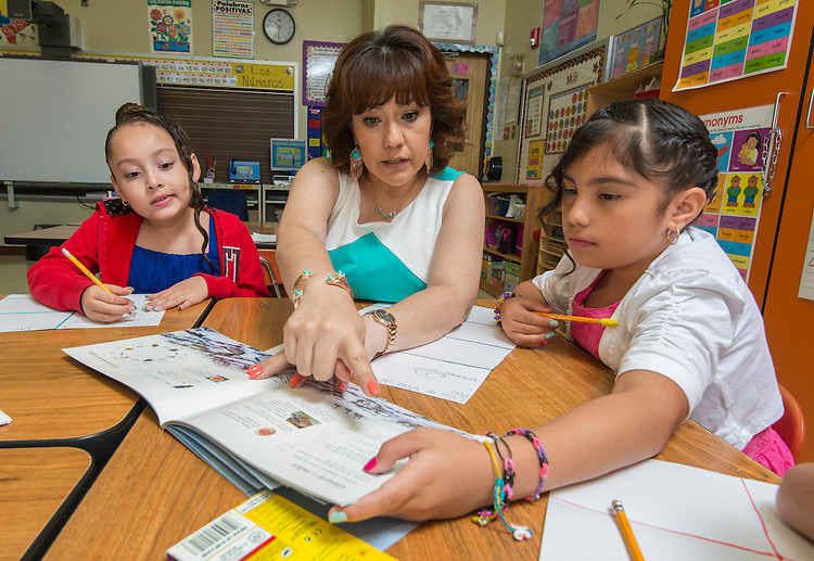 Sharon Samuel discusses life cycles with her second graders at J.P. Henderson Elementary School, May 16, 2014.
