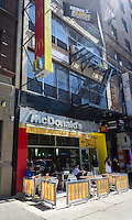 A McDonald's franchise and their sidewalk cafe in the Upper West Side neighborhood of New York on Saturday, August 24, 2013. (© Richard B. Levine)