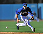 22 July 2011: Los Angeles Dodgers infielder Jamey Carroll warms up prior to a game against the Washington Nationals at Dodger Stadium in Los Angeles, California. The Nationals defeated the Dodgers 7-2 in their first meeting of the 2011 season. Mandatory Credit: Ed Wolfstein Photo