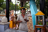 Nguyen Hoang lights incense to pray at the Giac Lam Pagoda in Tan Binh District in Ho Chi Minh City, Vietnam. Photo taken Tuesday, May 4, 2010....Kevin German / LUCEO