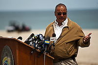 Seaside Heights mayor Bill Akers speak to the media while a crane works to remove remnants of the Jet Star roller coaster that had been left in the ocean after Superstorm Sandy hit Seaside Heights last year, in New Jersey  May 14, 2013, Photo by Eduardo Munoz Alvarez / VIEWpress.