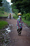 A woman in Riimenze, a village in Southern Sudan's Western Equatoria State, walks along a path on the first day of registration for the country's January 2011 referendum on secession from the north of the country. NOTE: In July 2011 Southern Sudan became the independent country of South Sudan.
