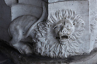 Sculptural detail of a lion with large mane and open mouth, on the South Portal, 1516-18, by Joao de Castilho, 1470ñ1552, after a design by Diogo de Boitaca, Church of Santa Maria, at the Jeronimos Monastery or Hieronymites Monastery, a monastery of the Order of St Jerome, built in the 16th century in Late Gothic Manueline style, Belem, Lisbon, Portugal. The portal consists of double doors with a tympanum carved with scenes from the life of St Jerome, a statue of Henry the Navigator, many carved statues in niches, a statue of the Madonna and many flamboyant pinnacles and gables in Manueline style. The monastery is listed as a UNESCO World Heritage Site. Picture by Manuel Cohen