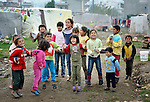 Refugee children from Syria, sing and dance in the street of their squatter settlement in the village of Jeb Jennine, in Lebanon's Bekaa Valley. Many refugee families in the area are being assisted by International Orthodox Christian Charities and other members of the ACT Alliance.