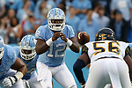 12 September 2015: UNC's Marquise Williams (12) takes a snap. The University of North Carolina Tar Heels hosted the North Carolina A&T State University Aggies at Kenan Memorial Stadium in Chapel Hill, North Carolina in a 2015 NCAA Division I College Football game.