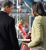 Washington, DC - January 20, 2009 -- United States President Barack Obama smiles down at his daughter Sasha Obama, 7, just after he was sworn-in as the 44th president of the United States and the first African-American to lead the nation, at the Capitol in Washington, Tuesday, January 20, 2009. First lady Michelle Obama is at right. .Credit: J. Scott Applewhite - Pool via CNP