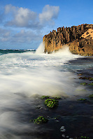 The surf rushes onto the rocky shore along the Maha'ulepu Heritage Trail, southern Kaua'i.