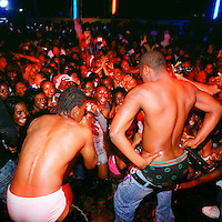 Kuduru or Kuduro musicians sing, dance and pose in the Luanda night club Esplanada 10..