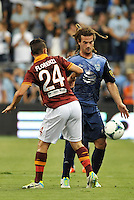 Sporting Park, Kansas City, Kansas, July 31 2013:<br /> Kyle Beckerman (23) midfield MLS All-Stars , llessandro Florenzi (24) midfield AS Roma.<br /> MLS All-Stars were defeated 3-1 by AS Roma at Sporting Park, Kansas City, KS in the 2013 AT &amp; T All-Star game.