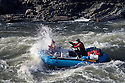 Whitewater rafting through Grave Creek Rapids on the Rogue River, Oregon.