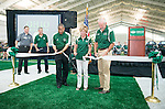 """Lead donors Robert D. and Margaret """"Peggy"""" M. Walter cut the ribbon with Ohio University President Roderick J. McDavis at the dedication of the Walter Fieldhouse. Photo by Ben Siegel/ Ohio University"""