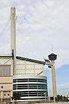 The AlamoDome, located on Interstate 35 in San Antonio, Texas, was finished in 1993.  Four 100-foot masts support the nine-acre roof.